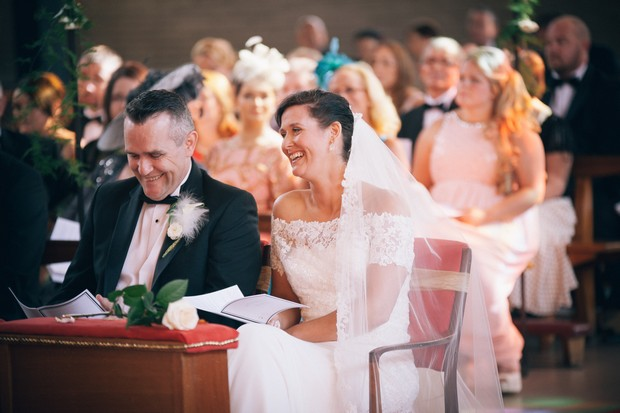 bride-and-groom-laughing-church-wedding-ceremony