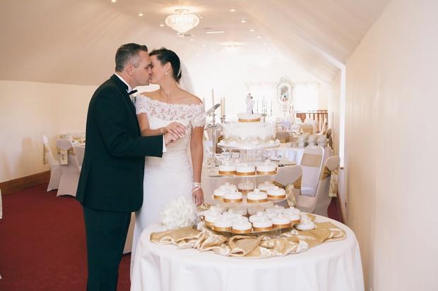 cupcake-wedding-cake-bride-and-groom-cutting-the-cake