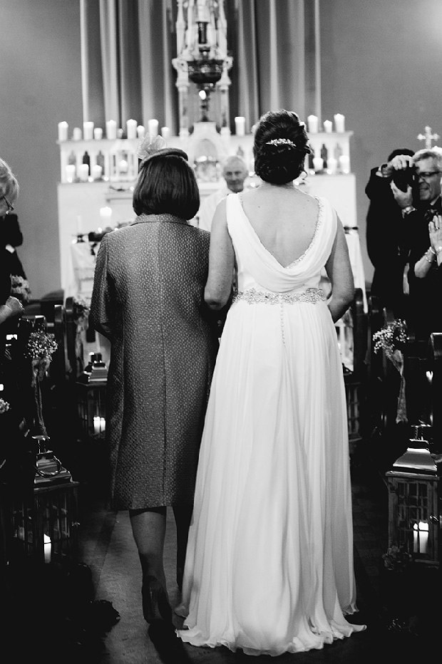 mother-walking-daughter-up-aisle