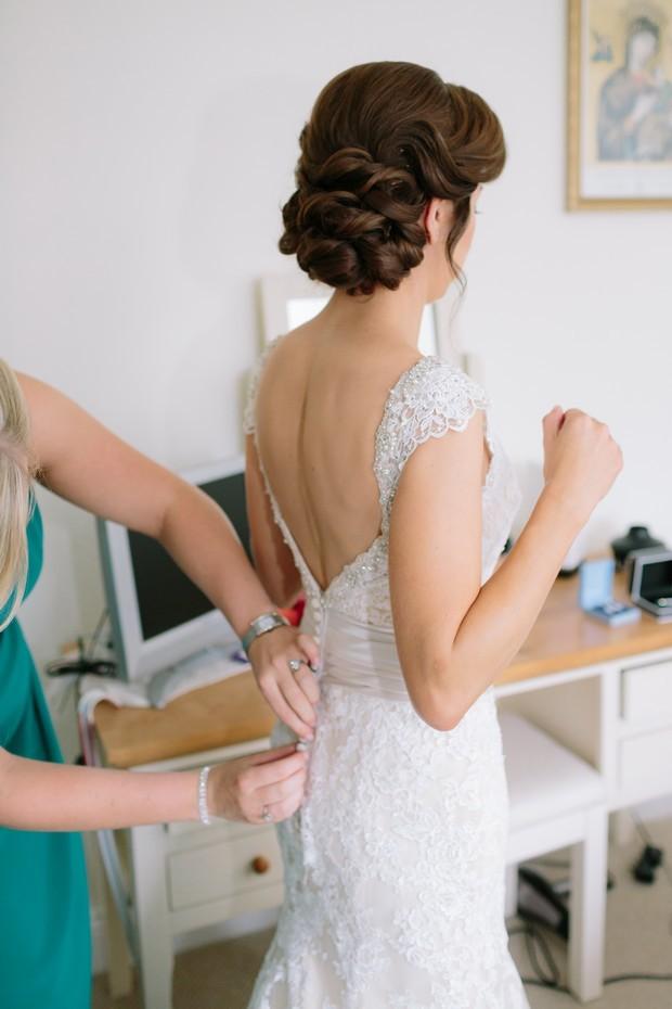14-Bridesmaid-wedding-dress-fitting-buttons
