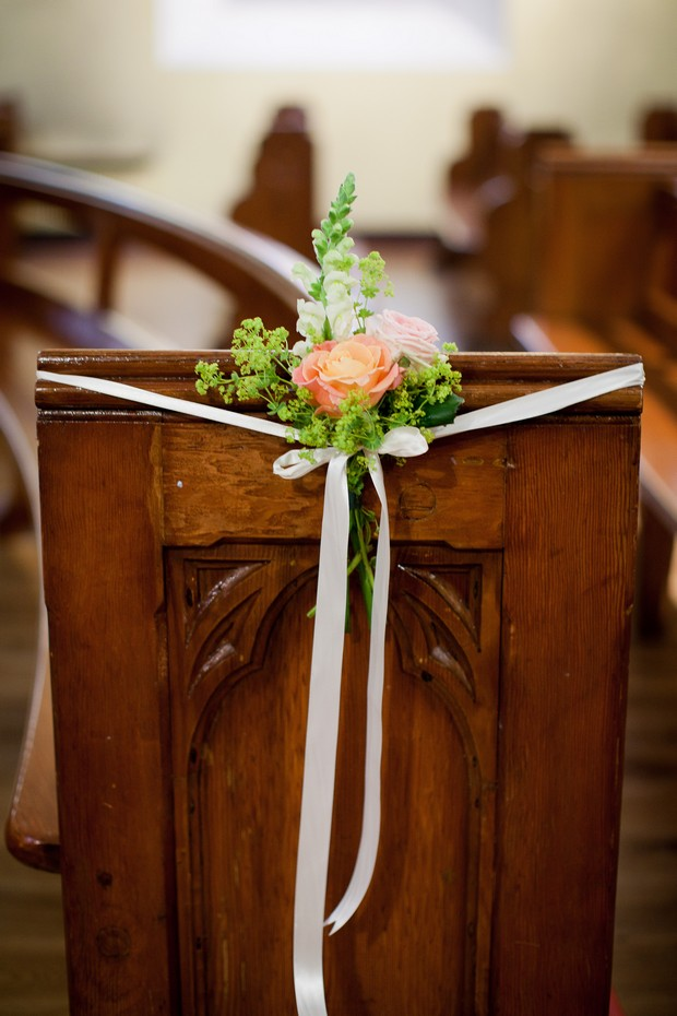 blush-pew-end-in-church-with-ribbon