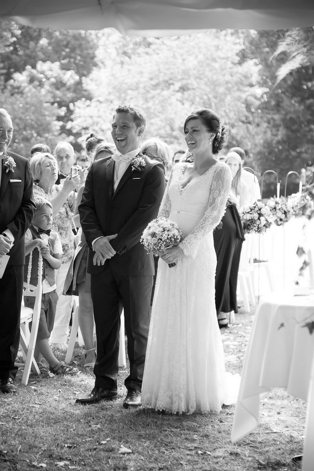 bride-and-groom-laughing-at-wedding-ceremony