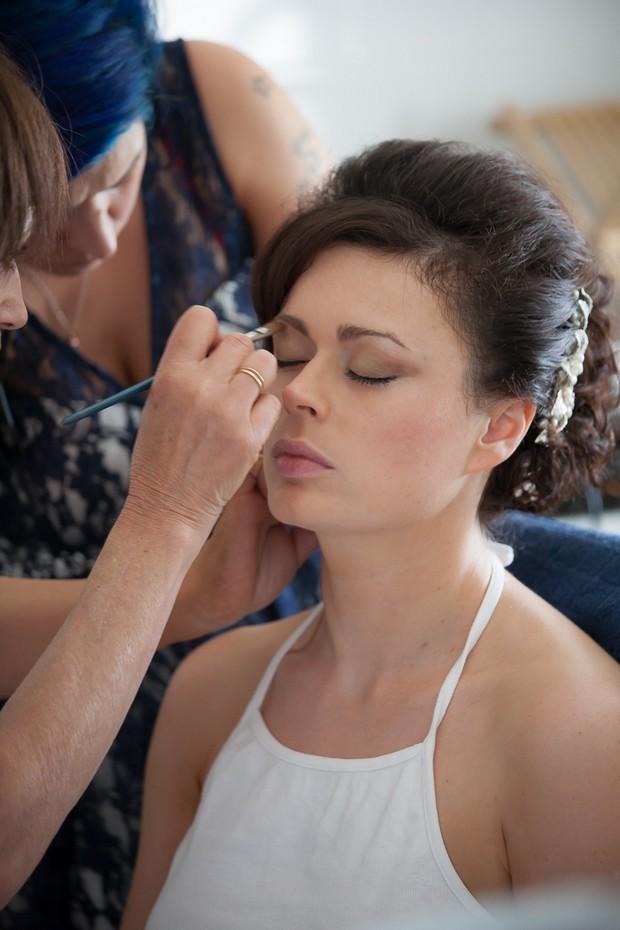 bride-getting-makeup-applied