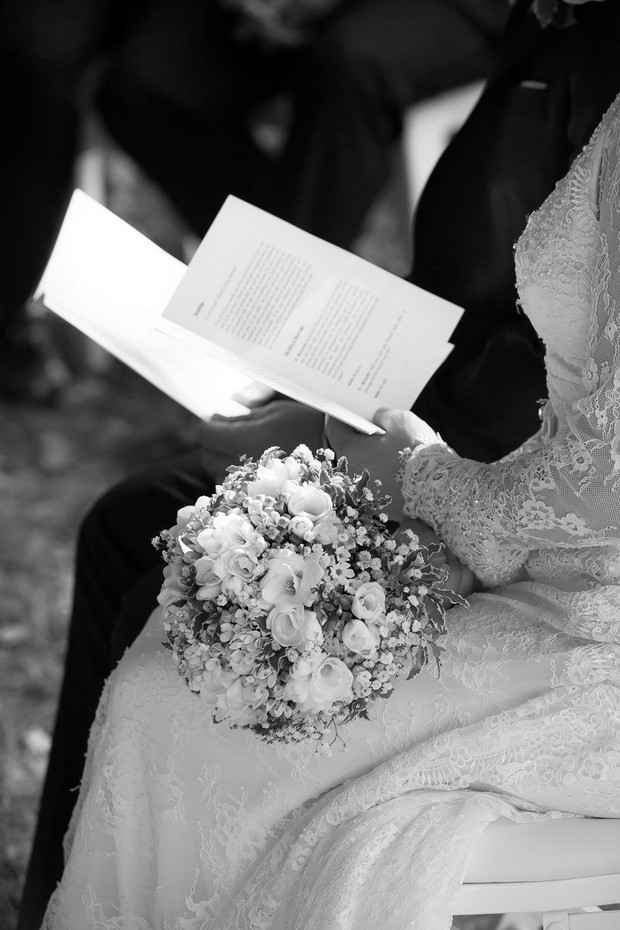 bride-holding-ceremony-booklet