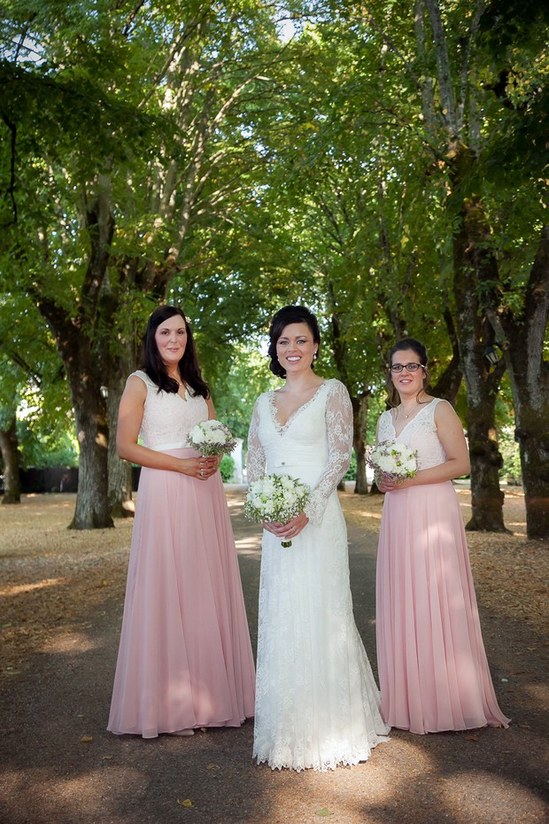 bride-with-bridesmaids-in-pink-lace-detail-dresses