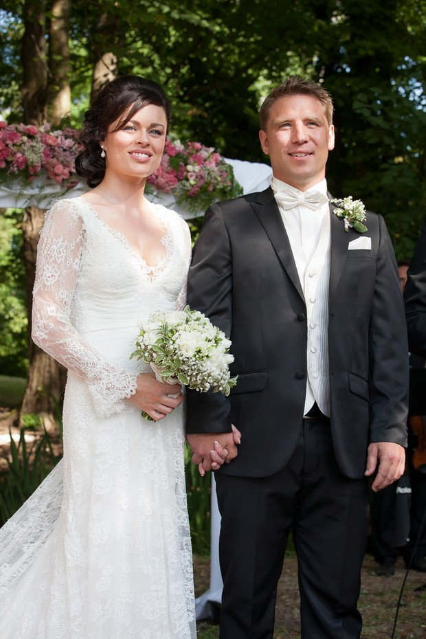 french-chateau-wedding-bride-and-groom-holding-hands