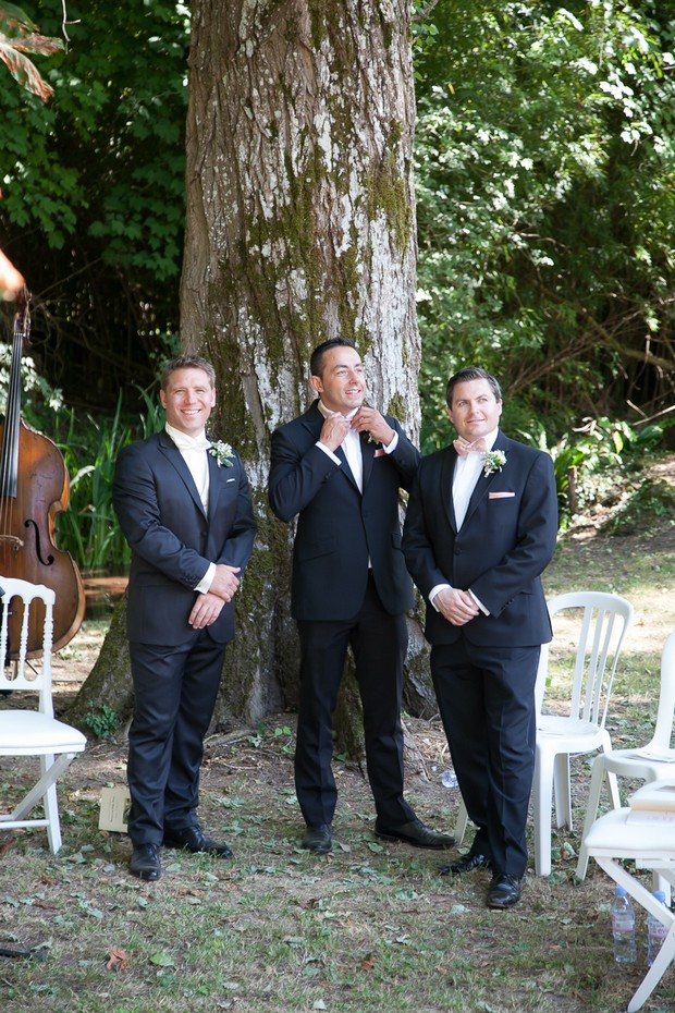 groom-and-groomsmen-waiting-at-wedding-ceremony