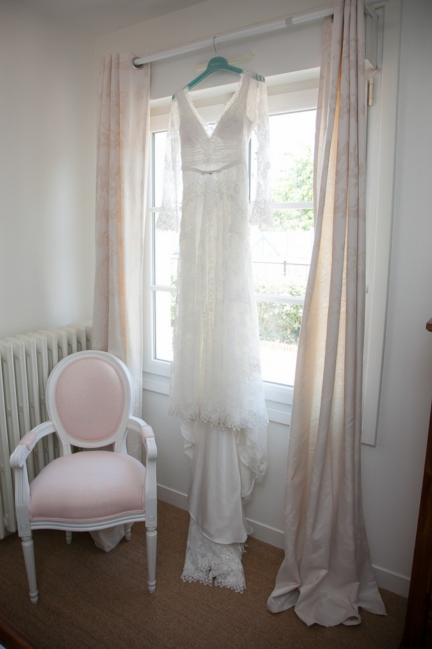 lace-long-sleeve-wedding-dress-hanging-on-window
