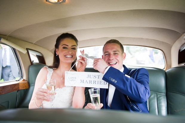 14-Bride-Groom-with-Just-Married-Sign