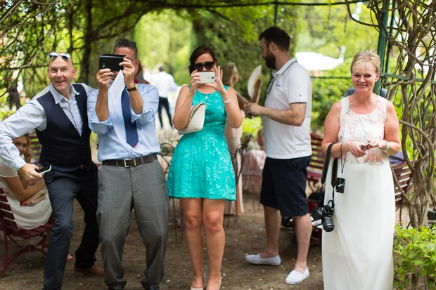 17-Wedding-guests-taking-photos-with-phones-weddingsonline