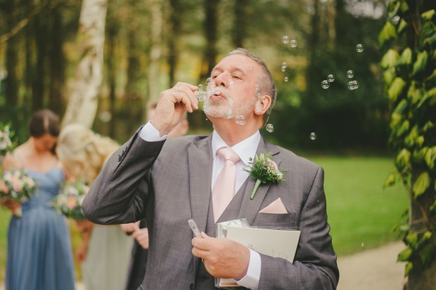 40-wedding-guests-blowing-bubbles-Emma-Russell-Photography-weddingsonline (1)