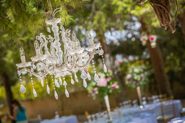 8-glamorous-outdoor-wedding-decor-chandelier-weddingsonline