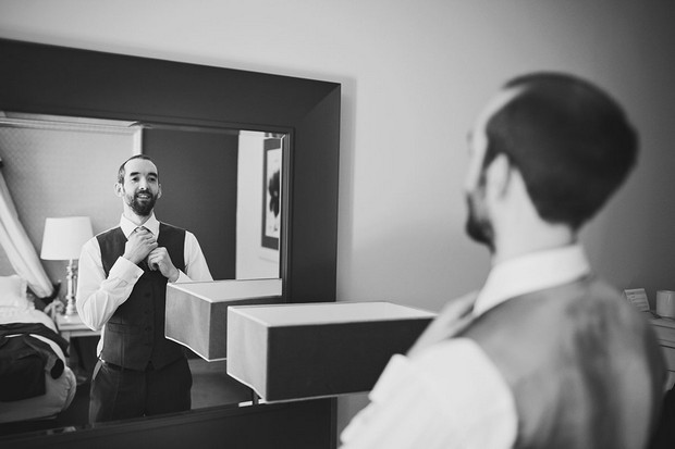 1-Groom-Getting-Read-Mirror-Photo-Fleeting-Moments