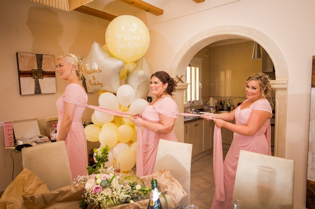 10-bridesmaids-getting-ready-dresses-line-up-weddingsonline