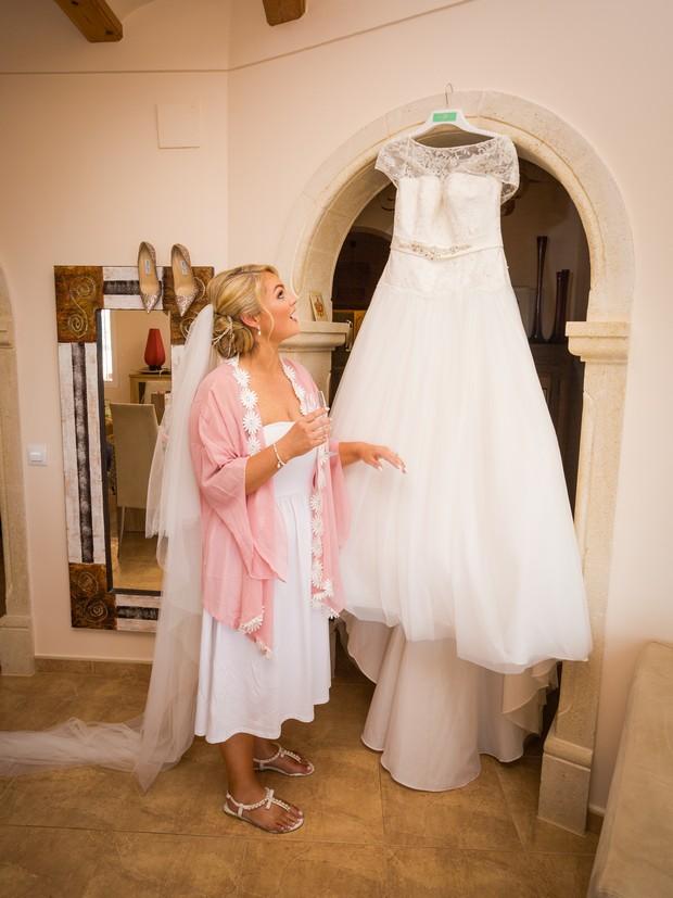 11-Wedding-Morning-Bride-Looking-Dress-Hanging-weddingsonline