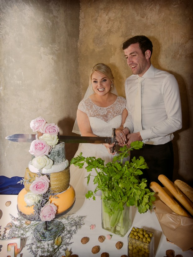 Real-wedding-cheese-wheel-cake-cut