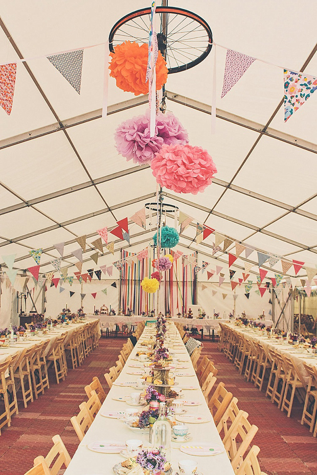 colourful-hanging-pom-poms-in-marquee