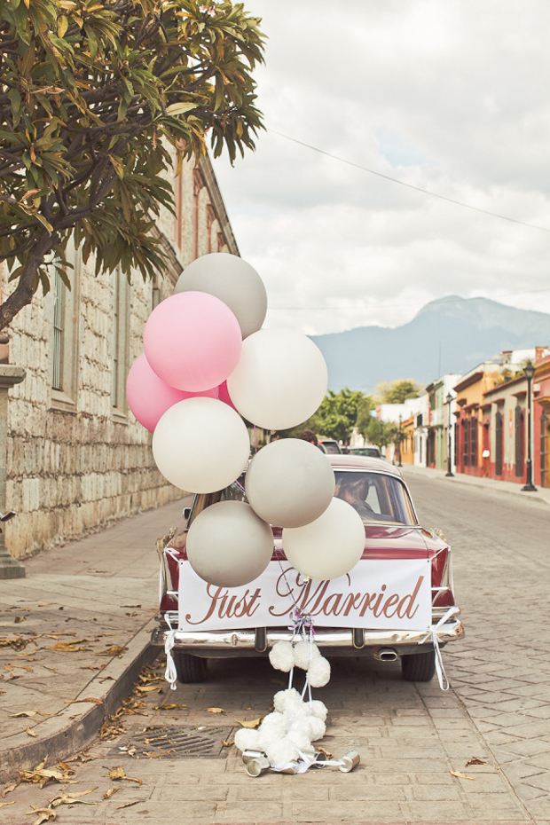 wedding-getaway-car-with-balloons-and-just-married-sign