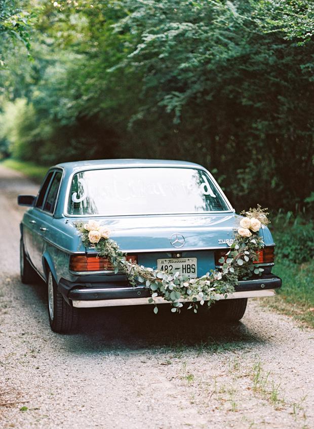 wedding-getaway-car-with-floral-garland