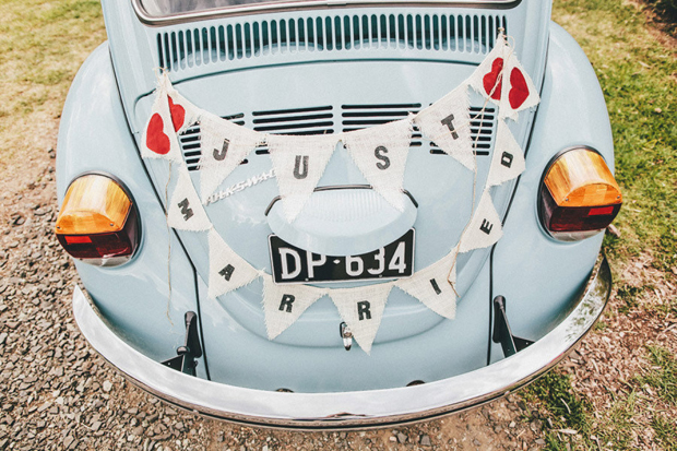 wedding-getaway-car-with-just-married-bunting