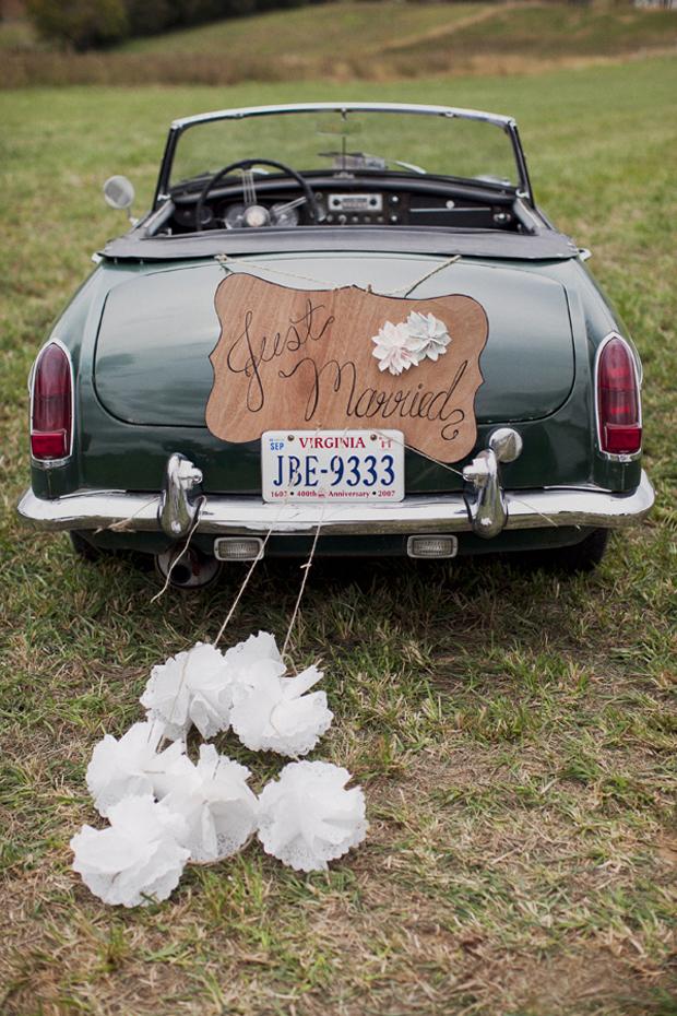 wedding-getaway-car-with-pom-poms