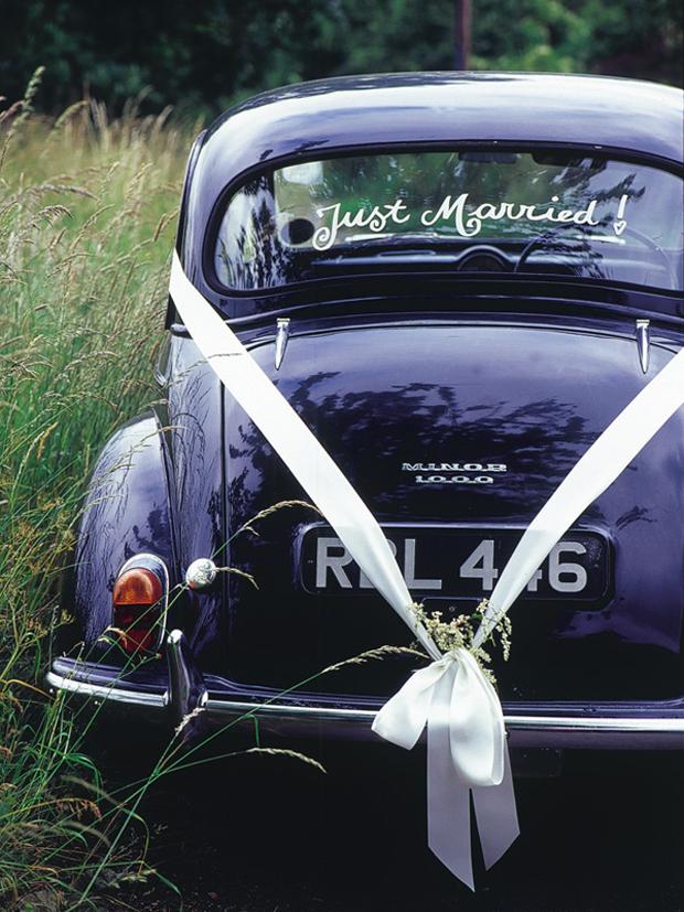 wedding-getaway-car-with-ribbon-bow
