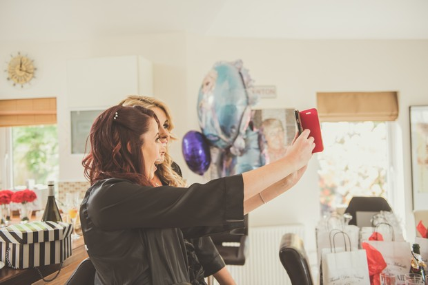 10-Bridesmaids-Taking-Selfie-Getting-Ready-Wedding-Photos-weddingsonline