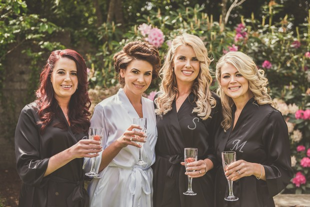6-Bride-Bridesmaids-Getting-Ready-Champagne-Robes-weddingsonline