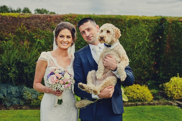 Bride-and-groom-with-pet-dog-wedding