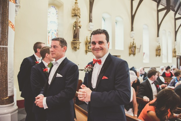 Groomsmen-waiting-altar-church-ceremony-Emma-Russell-Photography-weddingsonline