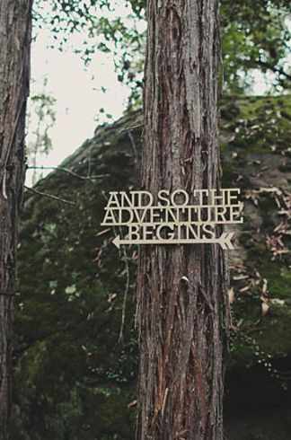 forest-wedding-theme-adventure-begins-sign