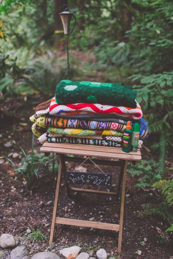 outdoor-forest-wedding-blankets-guests