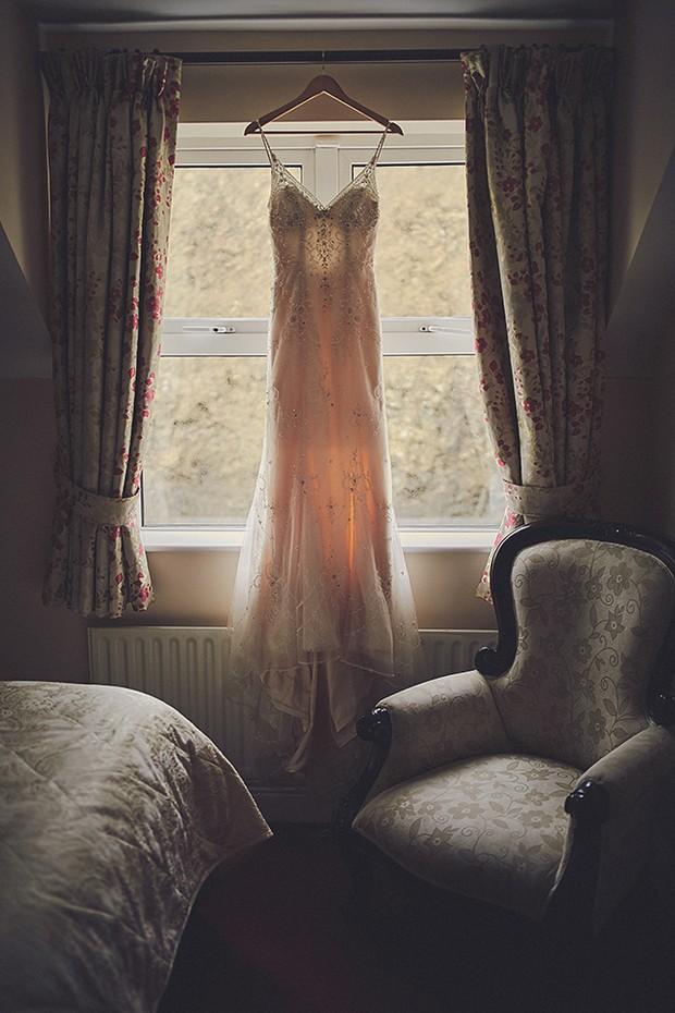 12-maggie-sottero-miela-wedding-dress-hanging-weddingsonline