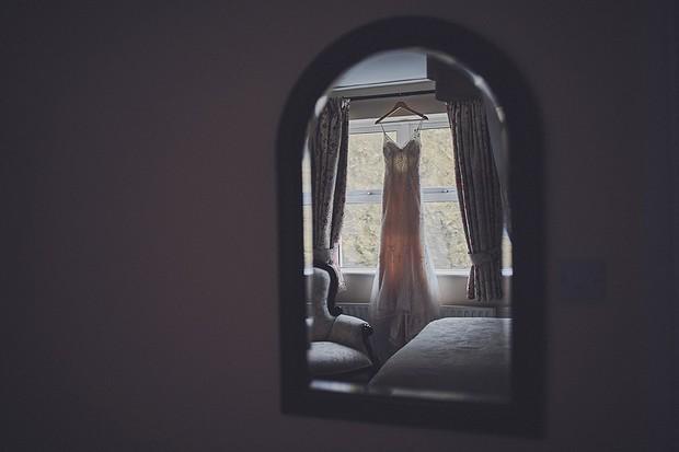 5-Hanging-Wedding-Dress-Reflection-Mirror-DKPhoto-weddingsonline