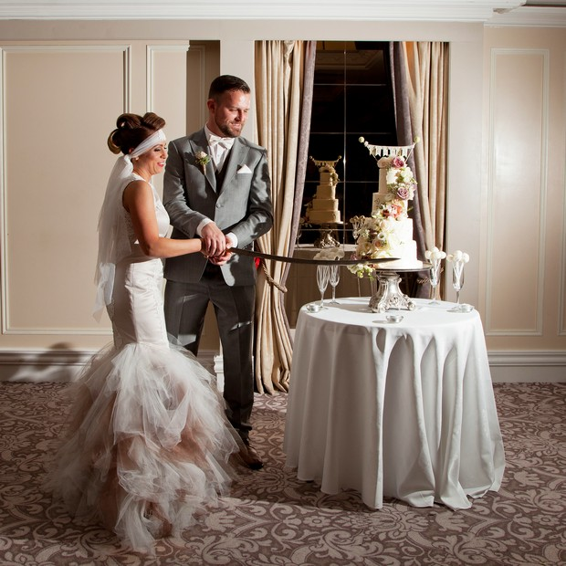 bellingham-castle-real-wedding-bride-groom-cutting-the-cake