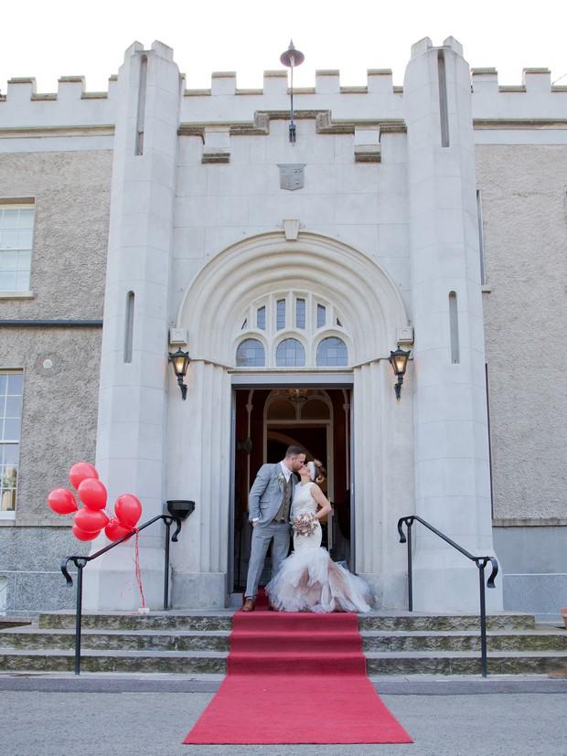 bellingham-castle-real-wedding-bride-groom-outside-castle