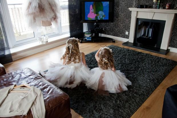 bellingham-castle-real-wedding-flower-girls-watching-tv