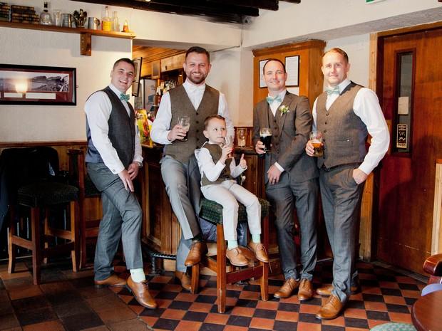 bellingham-castle-real-wedding-groom-and-groomsmen-having-pre-wedding-drink