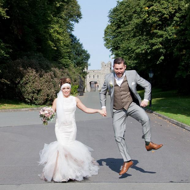bellingham-castle-real-wedding-groom-jumping