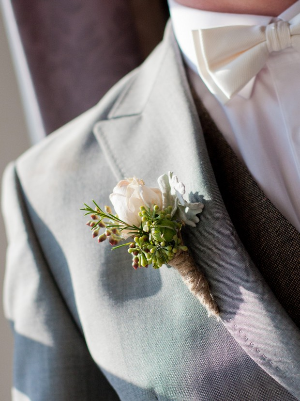 bellingham-castle-real-wedding-groom's-button-hole