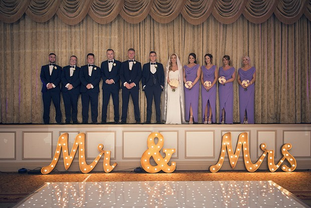 bridal-party-with-giant-mr-and-mrs-sign