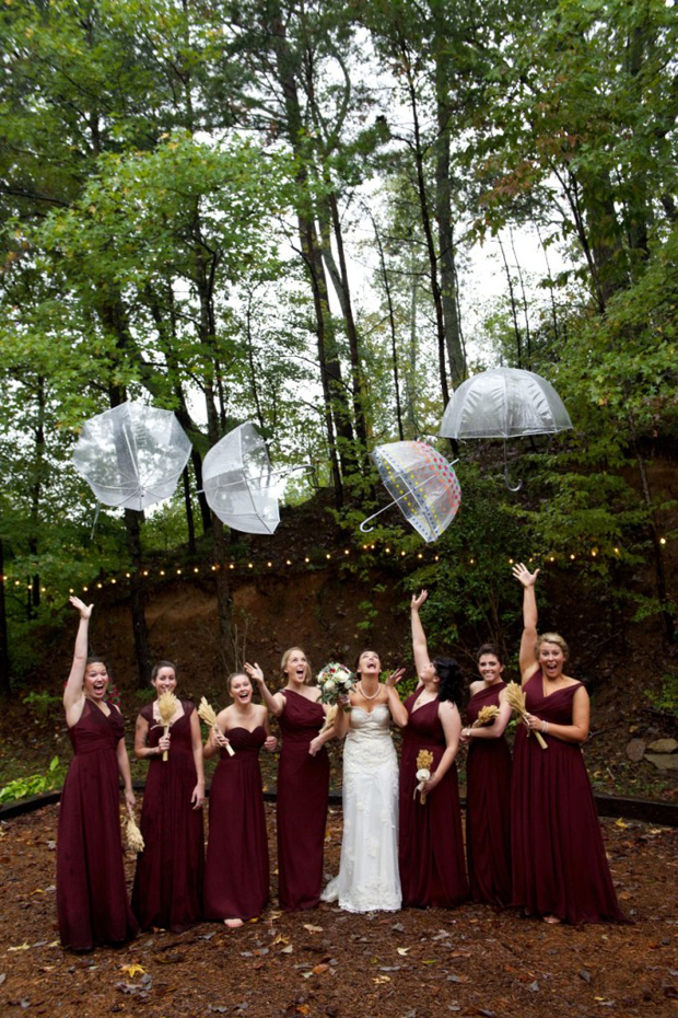 bride-and-bridesmaids-throwing-umbrellas-up-in-the-air-rainy-day-wedding-photos