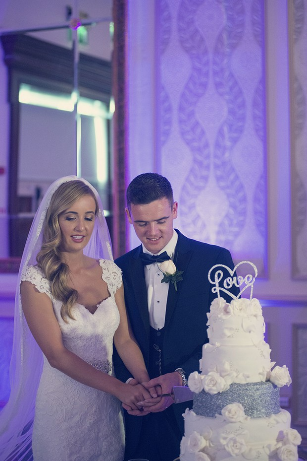 bride-and-groom-cutting-wedding-cake