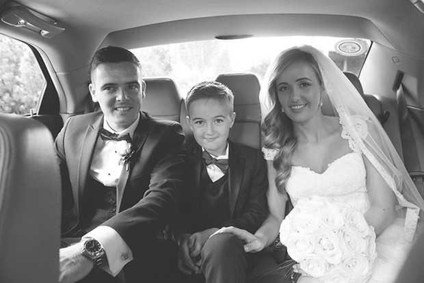 bride-and-groom-in-getaway-car-with-page-boy