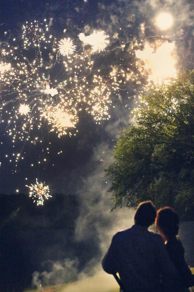 bride-and-groom-looking-at-wedding-fireworks