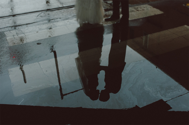 bride-and-groom's-reflection-in-the-puddle
