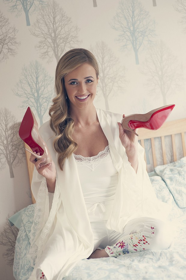 bride-holding-christian-laboutin-shoes