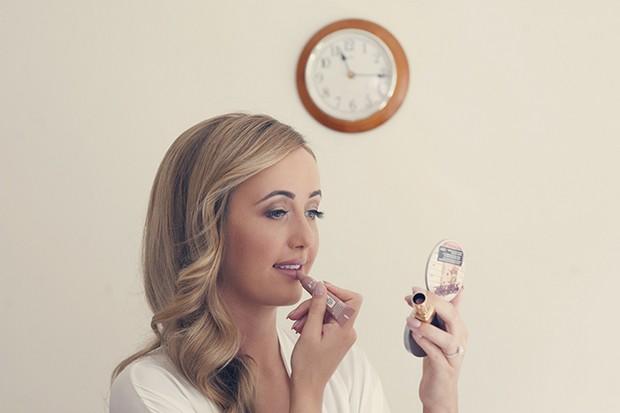 bride-touching-up-lipstick