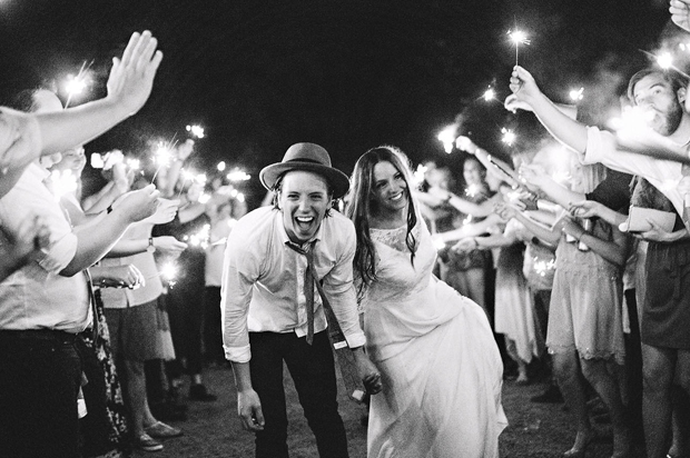 couple-surrounded-by-sparklers-wedding-entrance