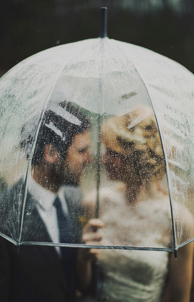 couple-under-umbrella-wedding-rainy-day-photos